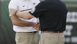 Oklahoma State head coach Mike Gundy, left, shakes hands with Baylor acting head coach Jim Grobe before an NCAA college football game Saturday, Sept. 24, 2016, in Waco, Texas. (AP Photo/LM Otero)