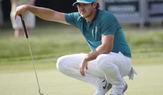 FILE - In this July 28, 2016, file photo, Brooks Koepka lines up a putt on the 14th hole during the first round of the PGA Championship golf tournament at Baltusrol Golf Club in Springfield, N.J.  Koepka is the lone American rookie on the Ryder Cup team who already has felt the sting of losing twice.  (AP Photo/Mike Groll, File)