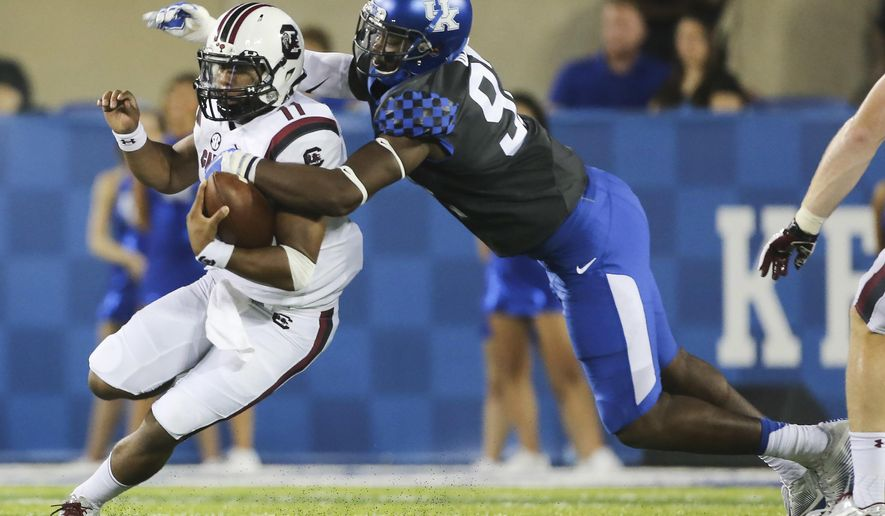 South Carolina quarterback Brandon McIlwain is tackled by Kentucky defensive end Alvonte Bell in the first half of an NCAA college football game Saturday, Sept. 24, 2016, in Lexington, Ky. (AP Photo/David Stephenson)