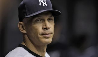 In this Wednesday, Sept. 21, 2016, photo, New York Yankees manager Joe Girardi watches play in the first inning of a baseball game against the Tampa Bay Rays in St. Petersburg, Fla. Girardi said he walked out of Friday's post-game media session because he was upset by questions about his bullpen usage, not because the slumping Yankees lost ground in the AL wild card race and were eliminated from the AL East. (AP Photo/Chris O'Meara)