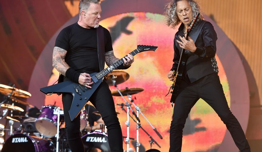 Musicians James Hetfield, left, and Kirk Hammett of Metallica perform at the 2016 Global Citizen Festival in Central Park on Saturday, Sept. 24, 2016, in New York. (Photo by Evan Agostini/Invision/AP)