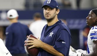 Dallas Cowboys quarterback Tony Romo carries a football as he watches his team warm up before an NFL football game against the Chicago Bears on Sunday, Sept. 25, 2016, in Arlington, Texas. (AP Photo/Ron Jenkins)