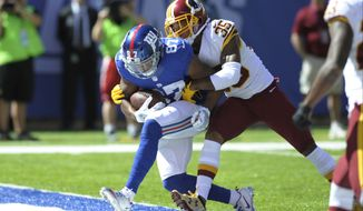 Washington Redskins defensive back Dashaun Phillips (35) tackles New York Giants' Sterling Shepard (87) as Shepard scores a touchdown during the first half of an NFL football game Sunday, Sept. 25, 2016, in East Rutherford, N.J.  (AP Photo/Bill Kostroun)