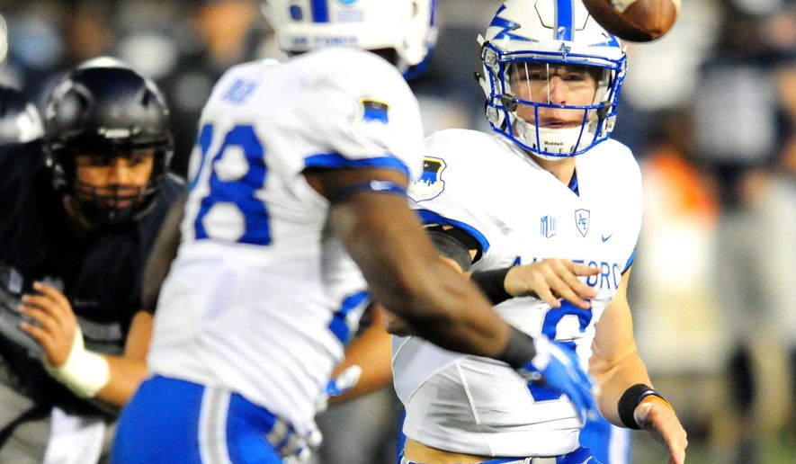 Air Force's Nate Romine pitches the ball off to Jacobi Owens during an NCAA college football game against Utah State, Saturday, Sept. 24, 2016, in Logan, Utah. (John Zsiray/Herald Journal via AP)