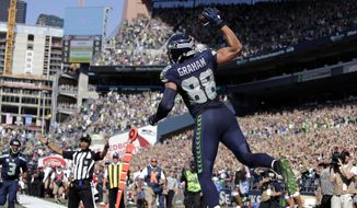 Seattle Seahawks' Jimmy Graham (88) leaps in celebration after scoring a touchdown against the San Francisco 49ers in the first half of an NFL football game, Sunday, Sept. 25, 2016, in Seattle. (AP Photo/John Froschauer)