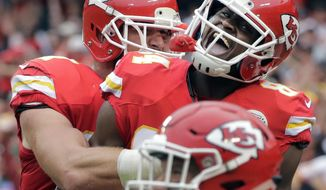 Kansas City Chiefs tight end Demetrius Harris (84) celebrates with tight end Travis Kelce (87) after making a touchdown on a fumble by the New York Jets during the first half of an NFL football game in Kansas City, Mo., Sunday, Sept. 25, 2016. (AP Photo/Charlie Riedel)