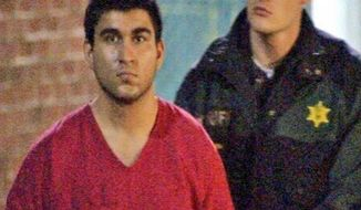 This late Saturday, Sept. 24, 2016, image from video by KIRO7 photographer Jeff Ritter shows suspected Cascade Mall shooter Arcan Cetin at Skagit County Jail in Mount Vernon, Wash., after his arrest in Oak Harbor, Wash., earlier in the evening. Investigators on Sunday tried to piece together information on the 20-year-old suspect in the deadly Washington state mall shootings who was apprehended after a nearly 24-hour manhunt. (Jeff Ritter/KIRO7.com via AP)
