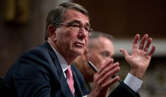 In this Sept. 22, 2016, file photo, Defense Secretary Ashton Carter, accompanied by Joint Chiefs Chairman Gen. Joseph Dunford, testifies on Capitol Hill in Washington. (AP Photo/Andrew Harnik, File)
