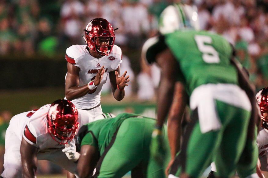 Louisville quarterback Lamar Jackson (8) awaits the snap during the first half of an NCAA college football game in Huntington, W. Va., Saturday Sept. 24, 2016. (AP Photo/Walter Scriptunas II)