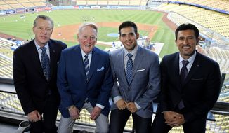 In this Tuesday, Sept. 20, 2016 photo, Dodgers broadcasters, from left, Orel Hershiser, Vin Scully, Joe Davis and Nomar Garciaparra pose prior to a baseball game between the Los Angeles Dodgers and the San Francisco Giants in Los Angeles. As Scully closes out his Hall of Fame career calling Los Angeles Dodgers games, his successor is waiting in the wings. Joe Davis has been working road games for the team this season, warming up for next year when the 28-year-old will move into Scully's old booth full-time. (AP Photo/Mark J. Terrill)
