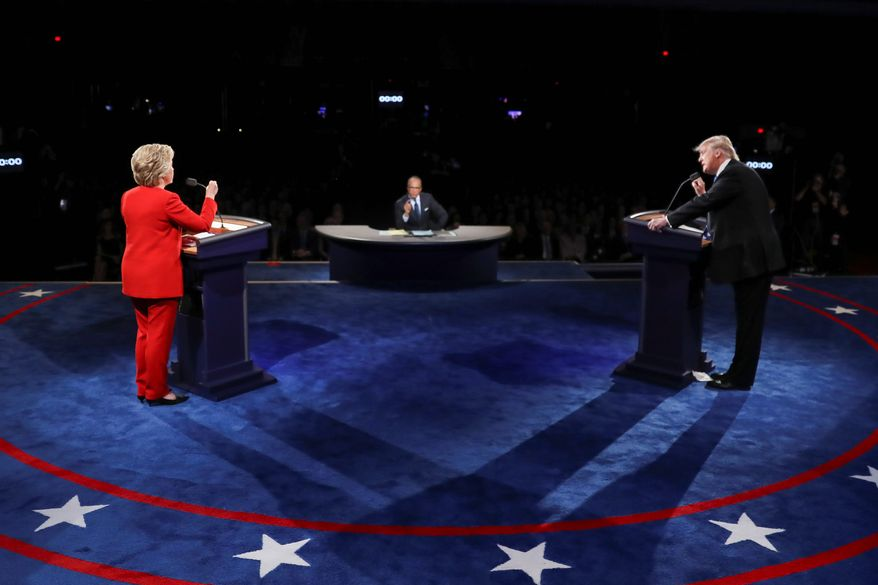 Democrat Hillary Clinton tried to get under Republican Donald Trump's skin by accusing him of coasting on his father's coattails as a businessman and saying he is a threat to the economy at the first presidential debate in Hempstead, New York. (Associated Press)