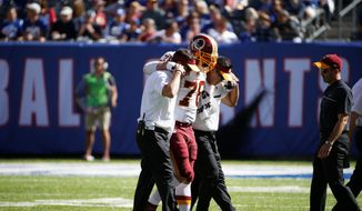 Washington Redskins center Kory Lichtensteiger has a moderate calf strain and will be evaluated on a week-to-week basis. (Associated Press)