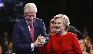 Democratic presidential nominee Hillary Clinton walks off the stage with her husband former President Bill Clinton after the presidential debate with Republican presidential nominee Donald Trump at Hofstra University in Hempstead, N.Y., Monday, Sept. 26, 2016. (Joe Raedle/Pool via AP) **FILE**