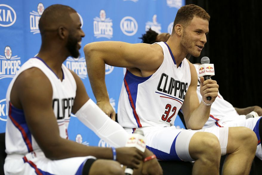 Los Angeles Clippers' Blake Griffin, center, responds to reporters while Chris Paul, left, and DeAndre Jordan laugh during the team's NBA basketball media day, Monday, Sept. 26, 2016, in Playa Vista, Calif. (AP Photo/Ryan Kang)