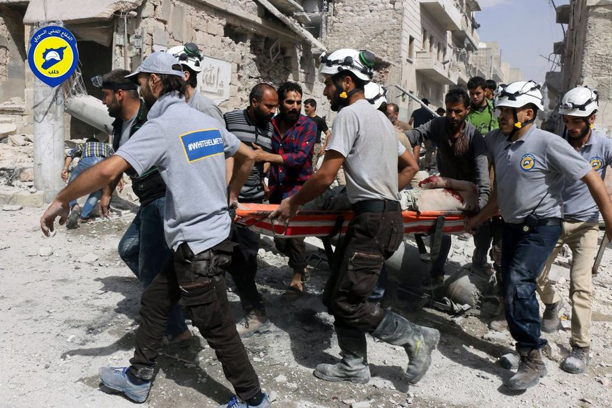 In this Wednesday, Sept. 21, 2016, file photo, provided by the Syrian Civil Defense White Helmets, rescue workers work the site of airstrikes in the al-Sakhour neighborhood of the rebel-held part of eastern Aleppo, Syria. Syrian Foreign Minister Walid al-Moallem said in a TV interview broadcast Monday, Sept. 26, 2016, that an internationally-brokered cease-fire for Syria is still viable, as rescue workers in Aleppo cleaned up from what they said were the worst airstrikes on rebel-held areas of the northern city in five years. Syria's military declared the cease-fire ended one week ago. (Syrian Civil Defense White Helmets via AP, File)