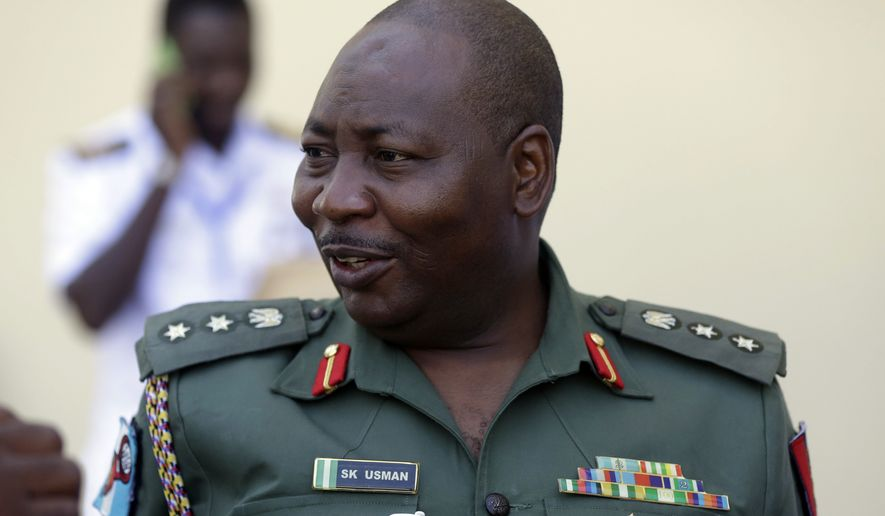 FILE- In this Tuesday May. 24, 2016 file photo, Nigeria Army spokesman Col. Sani Kukasheka Usman looks on, during an event in Lagos, Nigeria. Islamic extremists have killed eight soldiers and wounded 17 in two attacks in northeastern Nigeria, the country's military said Monday, Sept. 26, 2016 The attacks bring the official toll to 10 troops killed and 24 wounded this past week in a resurgence of violence after a lull as the extremists confronted a leadership struggle. (AP Photo/Sunday Alamba File)