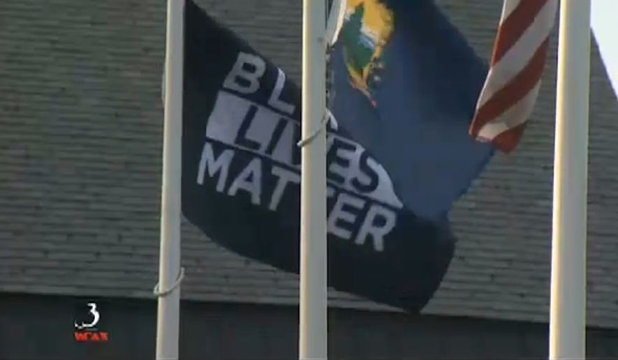 A Black Lives Matter flag hangs outside the University of Vermont. (WCAX screenshot) ** FILE **