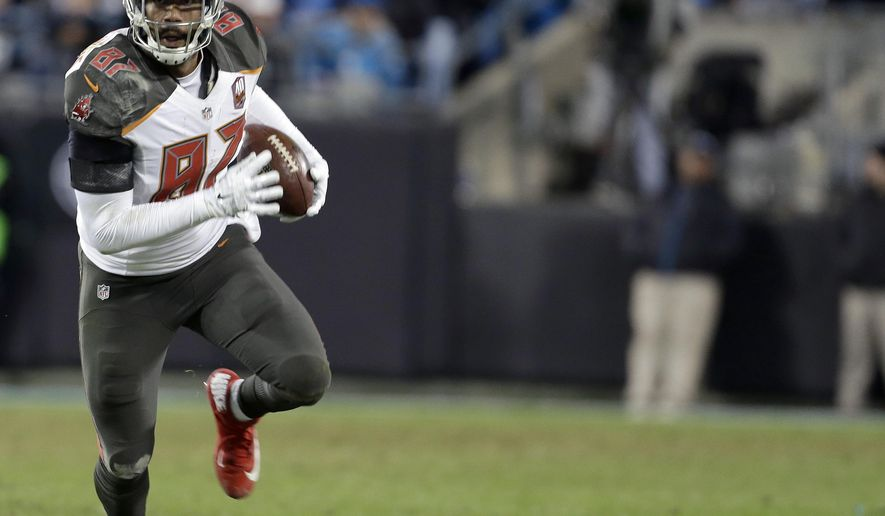 FILE - In this Jan, 3, 2016, file photo, Tampa Bay Buccaneers' Austin Seferian-Jenkins (87) runs all alone against the Carolina Panthers during the second half of an NFL football game in Charlotte, N.C. The New York Jets have claimed tight end Seferian-Jenkins off waivers from the Buccaneers, who cut him last week after he was arrested on suspicion of driving while under the influence. (AP Photo/Bob Leverone, File)
