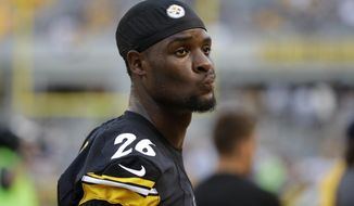 FILE - In this Aug. 12, 2016, file photo, Pittsburgh Steelers running back Le'Veon Bell stands on the sideline during the first half of an NFL exhibition football game against the Detroit Lions in Pittsburgh. Bell is eager to get back to work and put behind him the myriad of health and legal issues that have plagued him for the last 18 months. (AP Photo/Gene J. Puskar, File)