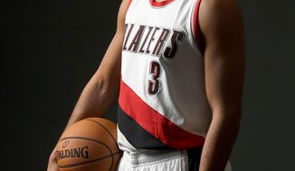 Portland Trail Blazers guard C.J. McCollum (3) poses for a photograph during NBA basketball media day in Portland, Ore., Monday, Sept. 26, 2016. (AP Photo/Steve Dykes)