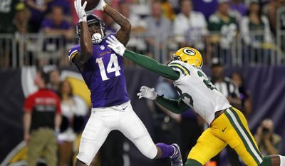 FILE - In this Sunday, Sept. 18, 2016, file photo, Minnesota Vikings wide receiver Stefon Diggs (14) catches a 25-yard touchdown pass over Green Bay Packers cornerback Damarious Randall, right, during the second half of an NFL football game in Minneapolis. When Sam Bradford arrived in Minnesota, the first player who caught his eye when he dived into the video of his new team was Diggs. The quarterback-receiver connection was evident in their first game together, an inspired victory over rival Green Bay in which Diggs piled up 182 yards on nine catches and a touchdown. (AP Photo/Andy Clayton-King, File)