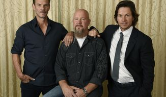 "In this Sept. 13, 2016 photo, Mike Williams, center, an electrician and survivor on the Deepwater Horizon oil rig, poses with Peter Berg, left, director of the film ""Deepwater Horizon,"" and cast member Mark Wahlberg at the Ritz-Carlton Hotel in Toronto. Berg's film is not about the environmental disaster of the Gulf of Mexico oil leak, nor an exploration of BP's responsibility for the accident. Instead, it's squarely focused on oil rig workers and the 11 who died in the explosion. (Photo by Chris Pizzello/Invision/AP)"