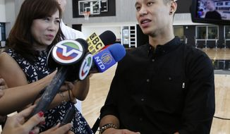 Brooklyn Nets new NBA basketball team player Jeremy Lin speaks to members of the Asian media during a press conference to introduce the team's new players Wednesday, July 20, 2016, in New York. s (AP Photo/Kathy Willens)