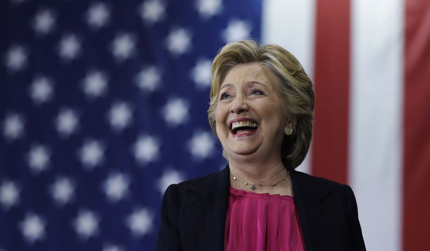 Democratic presidential candidate Hillary Clinton takes the stage at a campaign stop at Wake Technical Community College in Raleigh, N.C., Tuesday, Sept. 27, 2016. (AP Photo/Matt Rourke)