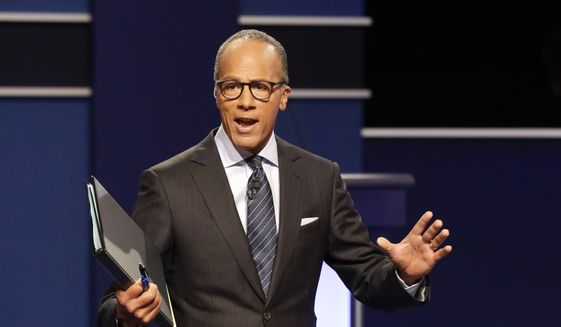 Moderator Lester Holt, anchor of NBC Nightly News, talks with audience before the presidential debate at Hofstra University in Hempstead, N.Y., Monday, Sept. 26, 2016. (AP Photo/David Goldman)