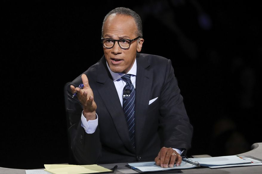 Moderator Lester Holt, anchor of NBC Nightly News, asks a question of Democratic presidential nominee Hillary Clinton during the presidential debate Republican presidential nominee Donald Trump at Hofstra University in Hempstead, N.Y., Monday, Sept. 26, 2016. (Joe Raedle/Pool via AP)
