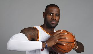 Cleveland Cavaliers forward LeBron James poses during a NBA basketball media day, Monday, Sept. 26, 2016, in Independence, Ohio. (AP Photo/Ron Schwane) ** FILE **