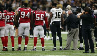 New Orleans Saints and Atlanta Falcons players form a unity circle before an NFL football game in New Orleans, Monday, Sept. 26, 2016. (AP Photo/Butch Dill)