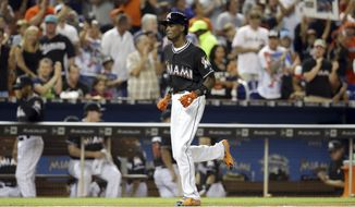 Miami Marlins Dee Gordon runs the bases after after he hit a solo home run during the first inning in a baseball game against the New York Mets, Monday, Sept. 26, 2016, in Miami. (AP Photo/Lynne Sladky)