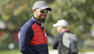 United States vice-captain Tiger Woods during a practice round for the Ryder Cup golf tournament Tuesday, Sept. 27, 2016, at Hazeltine National Golf Club in Chaska, Minn. (AP Photo/Charlie Riedel)