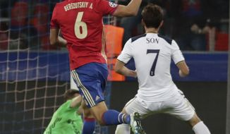 Tottenham's Son Heung-min, right, scores his side's first goal passing CSKA goalkeeper Igor Akinfeev, rear in green, during the Champions League Group E soccer match between CSKA Moscow and Tottenham Hotspur, in Moscow, Russia, Tuesday, Sept. 27, 2016. (AP Photo/Pavel Golovkin)