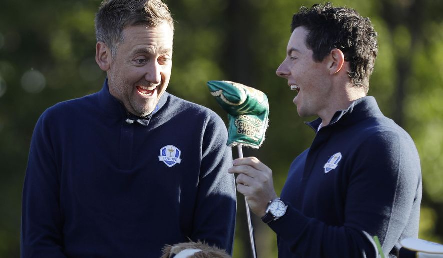 Europe vice-captain Ian Poulter shares a laugh with Rory McIlroy before a practice round for the Ryder Cup golf tournament Tuesday, Sept. 27, 2016, at Hazeltine National Golf Club in Chaska, Minn. (AP Photo/David J. Phillip)