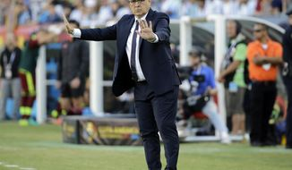 FILE - In this June 18, 2016 file photo, Argentina's coach Gerardo Martino instructs his team from the sideline during a Copa America Centenario quarterfinal soccer match with Venezuela in Foxborough, Mass. Atlanta United has hired Martino as coach for its 2017 inaugural MLS season. (AP Photo/Elise Amendola, File)
