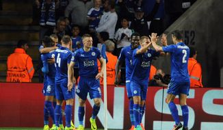 Leicester's players celebrate the opening goal of their team during the Champions League Group G soccer match between Leicester City and FC Porto at King Power Stadium, Leicester, England, Tuesday, Sept. 27, 2016. (AP Photo/Rui Vieira)