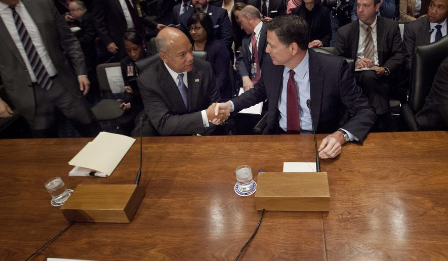 Homeland Secretary Jeh Johnson, left, shakes hands with FBI Director James Comey, on Capitol Hill in Washington, Tuesday, Sept. 27, 2016, prior to testifying before the Homeland Security and Governmental Affairs Committee hearing on on terror threats. (AP Photo/Pablo Martinez Monsivais)