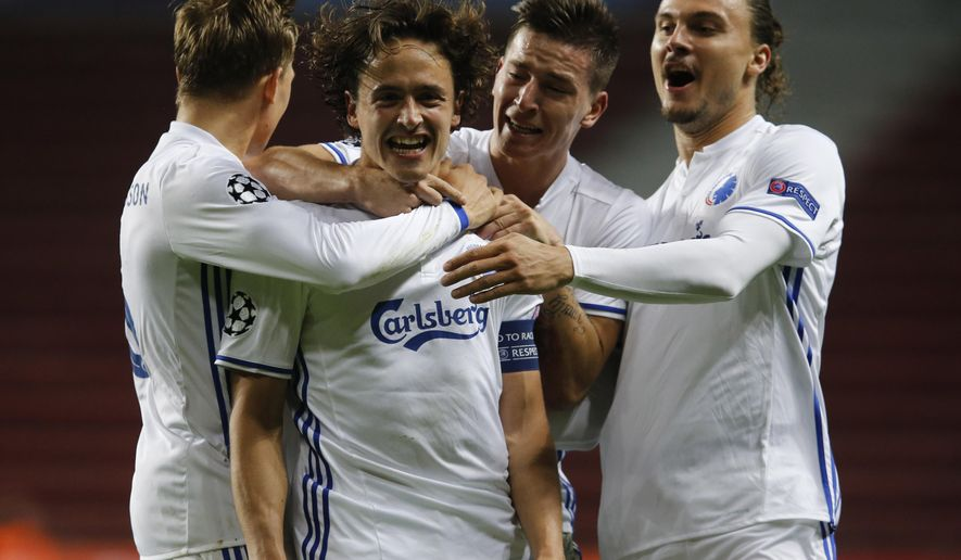 FC Copenhagen's Thomas Delaney, second left, after he scored his teams second goal during the Champions League Group G soccer match against Club Brugge Tuesday, Sept. 27, 2016, at Parken Stadium in Copenhagen, Denmark. (Jens Dresling/Polfoto via AP)