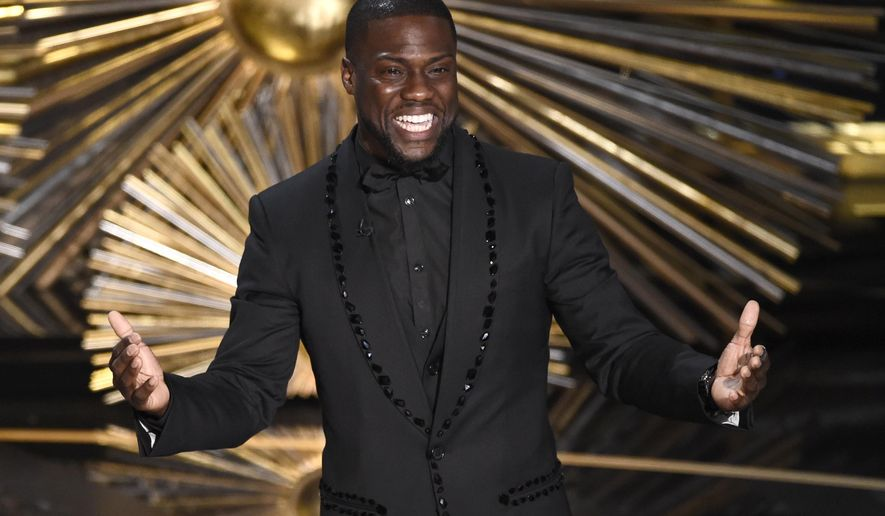"In this Feb. 28, 2016, file photo, Kevin Hart speaks at the Oscars at the Dolby Theatre in Los Angeles.  On Jan. 13, 2017, Variety reported Mr. Hart was producing a 2-hour special for the History Channel devoted to black history titled """"Kevin Hart Presents: The Black Man's Guide to History"" (Photo by Chris Pizzello/Invision/AP, File) **FILE**"