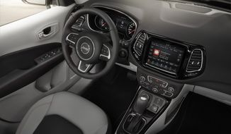 This undated photo provided by Fiat Chrysler Automobiles US LLC shows the interior of the redesigned Jeep Compass Limited SUV. The new Compass, unveiled at a factory in Brazil on Monday, Sept. 26, 2016, replaces a model that was introduced about a decade earlier and had fallen far behind rivals in what is now the largest segment of the U.S. auto market. It also will replace the Jeep Patriot, a similar-sized SUV. (Fiat Chrysler Automobiles US LLC via AP) ** FILE **