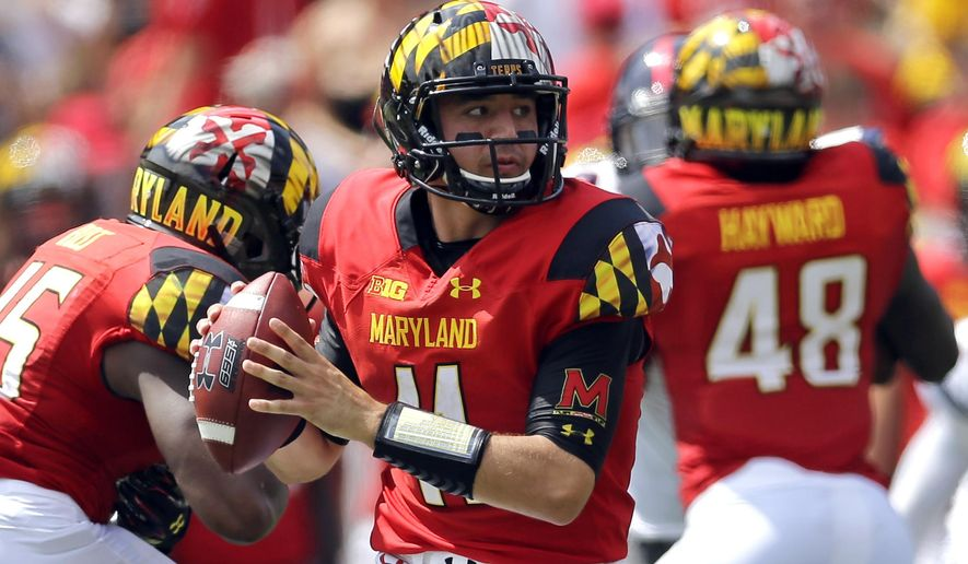FILE - In this Sept. 5, 2015, file photo, Maryland quarterback Perry Hills looks for a receiver in the first half of an NCAA college football game against Richmond,in College Park, Md. Though first-year coach DJ Durkin is known for his defensive prowess, Maryland is unbeaten because of an attack that has rung up 123 points, second-most in school history after three games. (AP Photo/Patrick Semansky, FIle)