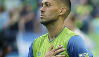 FILE - In this Aug. 21, 2016, file photo, Seattle Sounders forward Clint Dempsey holds his hand over his heart during the national anthem before an MLS soccer match against the Portland Timbers in Seattle. The Sounders announced Tuesday, Sept. 27, 2016 that Dempsey would miss the rest of the 2016 season due to health concerns related to an irregular heartbeat. (AP Photo/Ted S. Warren, file)