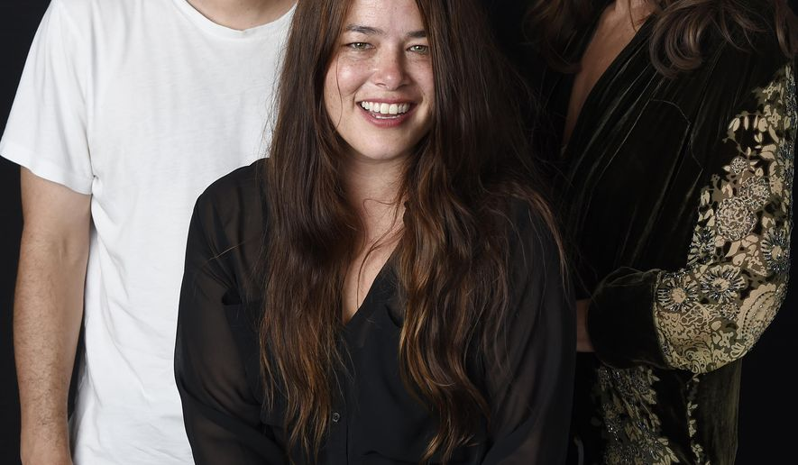 """In this Sept. 1, 2016 photo, singer Rachael Yamagata, center, poses with Josh Radnor,  director of Yamagata's music video for her song """"Let Me Be Your Girl,"""" and actress Allison Janney, who appears in the video, at H.Q. Avalon Studios in Los Angeles. (Photo by Chris Pizzello/Invision/AP)"""