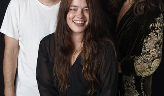"In this Sept. 1, 2016 photo, singer Rachael Yamagata, center, poses with Josh Radnor,  director of Yamagata's music video for her song ""Let Me Be Your Girl,"" and actress Allison Janney, who appears in the video, at H.Q. Avalon Studios in Los Angeles. (Photo by Chris Pizzello/Invision/AP)"
