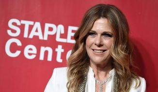 In this Feb. 13, 2016, file photo, Rita Wilson arrives at the MusiCares Person of the Year tribute honoring Lionel Richie at the Los Angeles Convention Center. (Photo by Jordan Strauss/Invision/AP, File)