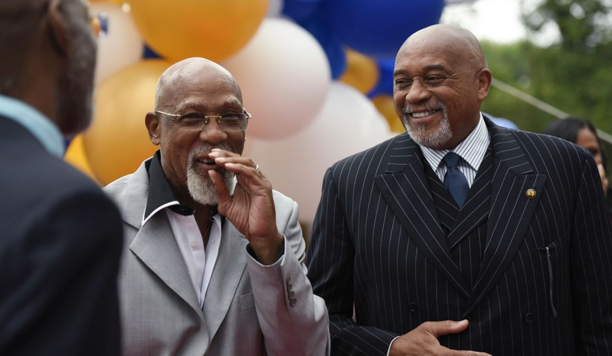 John Carlos, left, and Tommie Smith smile during an event in Washington on Wednesday, Sept. 28, 2016. Carlos and Smith voiced their support for Colin Kaepernick and other athletes staging national anthem protests, 48 years after they raised their gloved fists on the podium in a symbolic protest at the Olympics. (AP Photo/Sait Serkan Gurbuz)