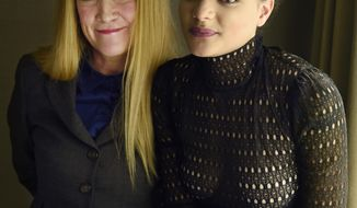 "In this Sept. 11, 2016 photo, writer-director Andrea Arnold, left, and cast member Sasha Lane, from the film, ""American Honey,"" pose at the InterContinental Toronto Centre in Toronto. The film  is a cross-country road trip of aimless but colorful youths selling magazines door-to-door as a way to party across the Midwest. (Photo by Chris Pizzello/Invision/AP)"