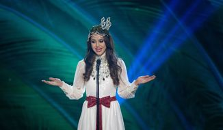 Miss Sweden, Camilla Hansson, poses for the judges, during the national costume show during the 63rd annual Miss Universe Competition in Miami, Fla., Wednesday, Jan. 21, 2015. (AP Photo/J Pat Carter)